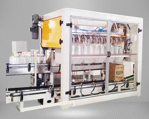 跌落式装箱机_自动桶装油装箱机——中国迅捷灌装机械品牌